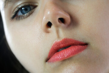 The picture of a beautiful woman, she has red lips, makeup and eyes. Modern woman style