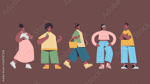 Wall mural set cute people in casual trendy clothes african american men women standing in different poses male female cartoon characters collection full length horizontal vector illustration
