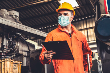 Factory workers with face mask protect from outbreak of Coronavirus Disease 2019 or COVID-19....