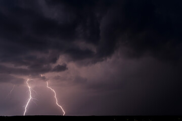 Lightnings in Summer Storm with Dramatic Clouds