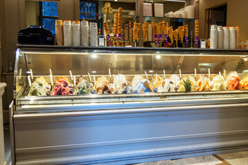 Italian ice-cream shop. Counter with different varieties of ice cream in Siena. Ittaly