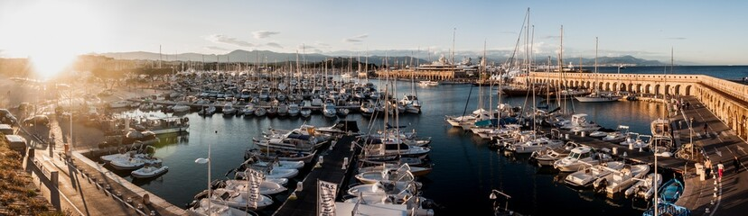 Panorama picture of white boats in a port