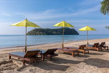 Fototapeta yellow beach umbrella and sunbed, Koh Mak beach, Koh Mak Island , Thailand.