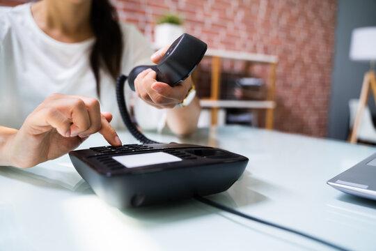 Businesswoman Hand Making Landline Telephone Call