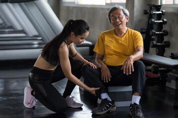 massage old man leg. First aid in gym.
