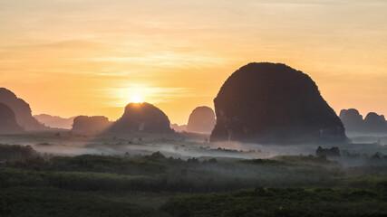 Beautiful sunrise at mountain and mist