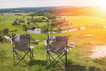 Poster Jaune de seuffre Two camping chairs standing on a hill with a beautiful view