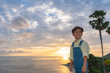 .A boy have fun at Promtep cape..Promthep cape is the most popular viewpoint in Phuket island. the most tourist always come to see sunset at this landmark