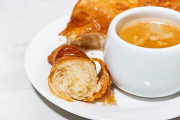 espresso and fresh croissants, closeup