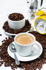 espresso cup on coffee beans, vertical