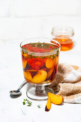 flavored black tea with plums, berries and thyme, vertical top view