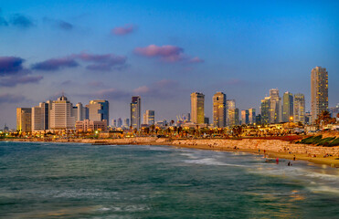 Skyline and sand beach of Tel Aviv city on sunset, Israel