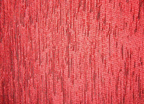 Texture of a red fabric cover for furniture with copy space