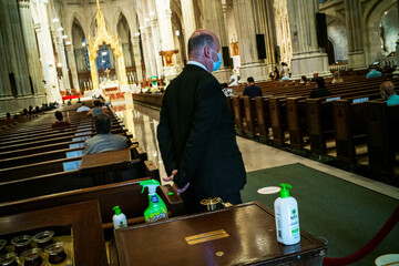 Hand sanitizer and germ killer spray are seen inside of St. Patrick's Cathedral as Cardinal Dolan celebrates mass during the outbreak of the coronavirus disease (COVID-19) in the Manhattan borough of New York City, New York