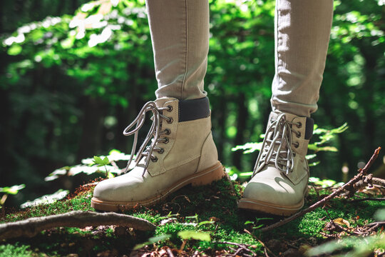 Hiker standing in forest. Hiking boot