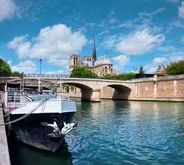 Undamaged east facade of Notre Dame de Paris in Springtime before the fire. Seasonal Summer travel background, panoramic image of undamaged famous French landmark by river Seine.