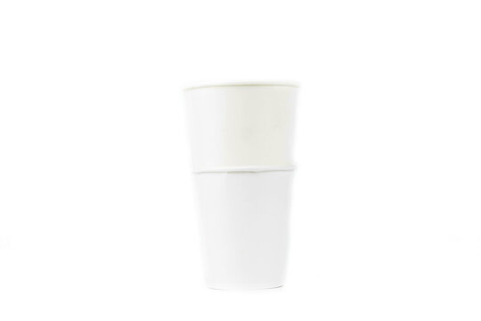 A row of paper coffee cups on a white background.Glasses for coffee and tea of different sizes isolated on white background. Hot coffee, starbucks.