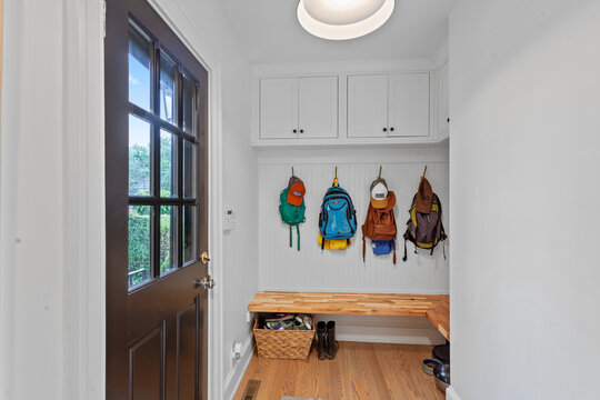 Mudroom with backpacks and outdoor door