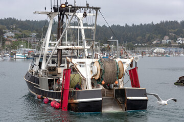 Fishing vessel returning to port in Newport Oregon.