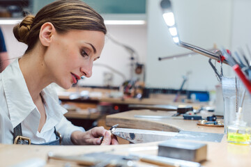 Jeweler working with tools on a piece of jewelry