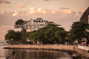 Beautiful sunset view to Urca ocean shore with people socializing