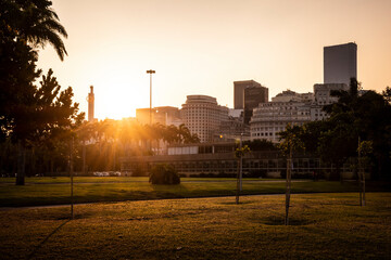 Beautiful sunset view to downtown buildings from green area