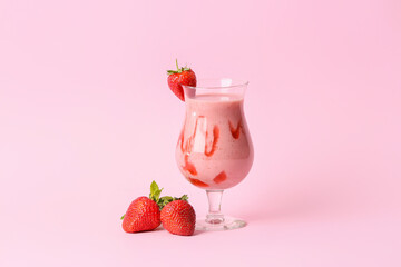 Glass of tasty strawberry smoothie on color background