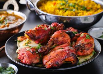 Foto op Plexiglas Kip indian tandoori chicken with onions and cilantro