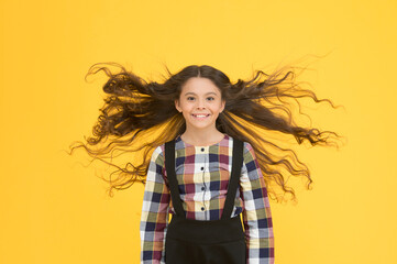 Extra light. Air in her hair. natural beauty. Girl kid long hair flying in air. Child with natural...