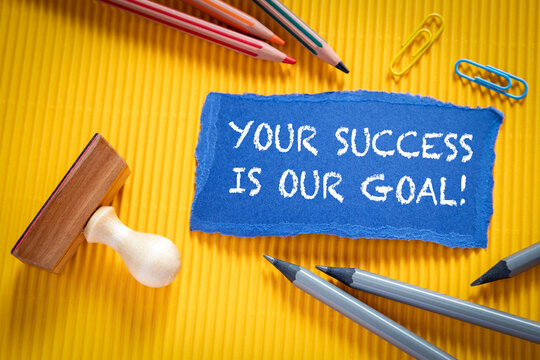 YOUR SUCCESS IS OUR GOAL. Text on torn, colored paper