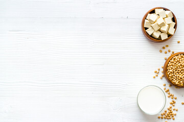 vegan soy milk with soy beans on white background top-down copy space