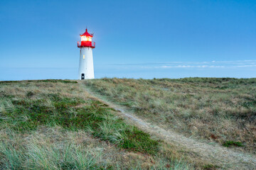 Wall Mural - Lighthouse List West at dusk, Sylt, Schleswig-Holstein, Germany