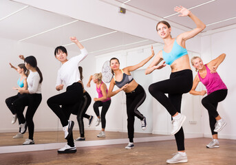 Women dancing aerobics at lesson in the dance class
