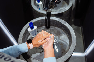 Woman washing hands to protect against the coronavirus