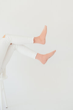 pink socks with white jeans
