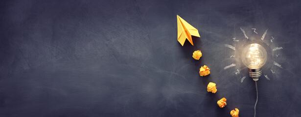 Obraz Education concept image. Creative idea and innovation. Light bulb as metaphor over blackboard - fototapety do salonu
