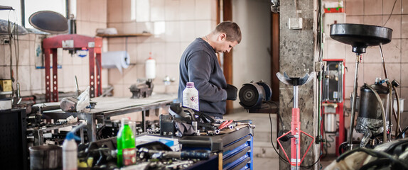 Car master mechanic working in auto vulcanizing and vehicle service workshop