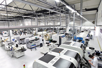 modern industrial factory for the production of electronic components - machinery, interior and...