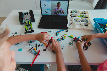 kids building robot with online robotic technology lesson