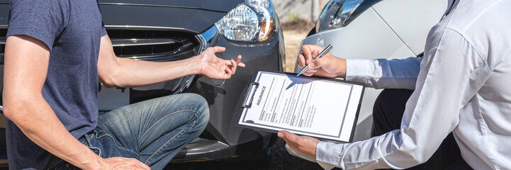 Insurance agent examine the damage of the car after accident on report claim form process