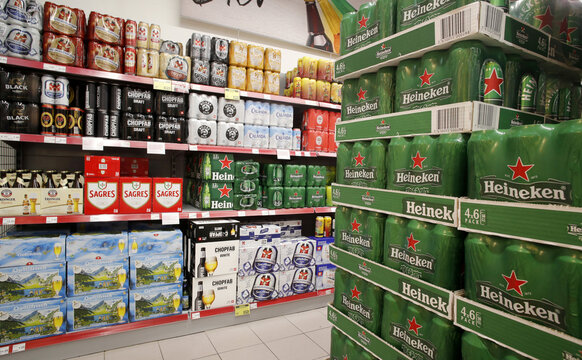 Cans and bottles of beer are displayed at a supermarket of Swiss retailer Denner in Glattbrugg