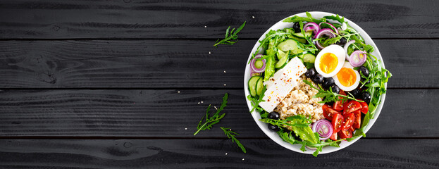 Greek style healthy breakfast bowl with oatmeal porridge and fresh vegetable salad of lettuce,...