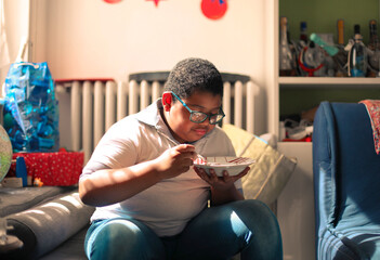 child eats at home from a plate