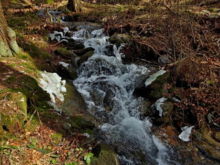 Czech Republic-view of Kalna brook with remnants of ice in spring near town Svoboda n / U