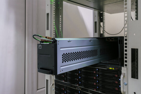 Large battery close-up. Changing the power module in the server room close-up. Working with equipment in the datacenter rack