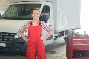 portrait of a professional female mechanic in a garage