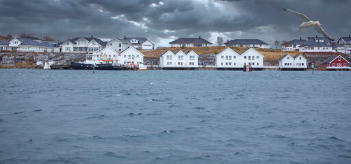 Dark clouds and house by the sea in Brønnøysund, Northern Norway