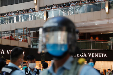 Riot police patrol at a shopping mall during a protest after China's parliament passes national security law for Hong Kong, in Hong Kong