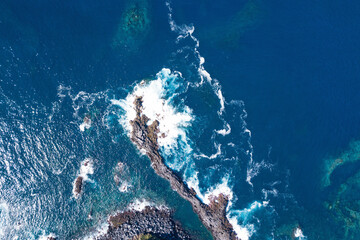 Aerial landscape ocean serf on the San Miguel island, Azores, Portugal.