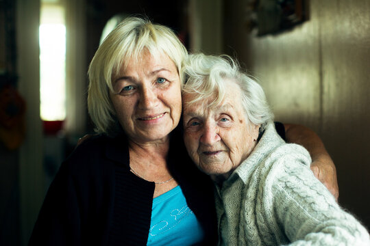 Portrait of mature woman together with her old mother.
